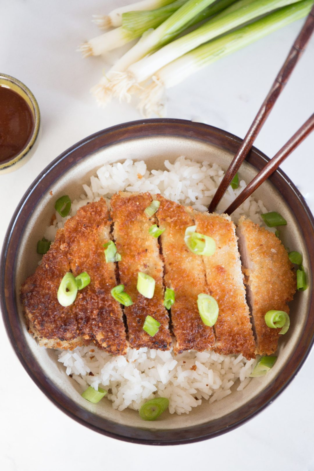 Japanese pork tonkatsu is a traditional dish made up of breaded and fried pork cutlet. The juicy pork on the inside, and the crispy, breaded outer coating creates a delicious meal that is hard to pass up!   wanderzestblog.com #tonkatsu