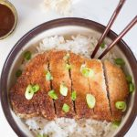 Japanese pork tonkatsu is a traditional dish made up of breaded and fried pork cutlet. The juicy pork on the inside, and the crispy, breaded outer coating creates a delicious meal that is hard to pass up!   wanderzestblog.com