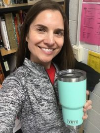 Kathleen Trace holding a YETI water bottle