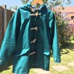 turquoise raincoat
