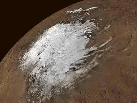 Mars's southern polar ice cap, seen here in true color, has shrunk in recent years due to planetary warming—similar to what's happening on Earth.