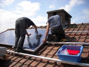 men setting solar