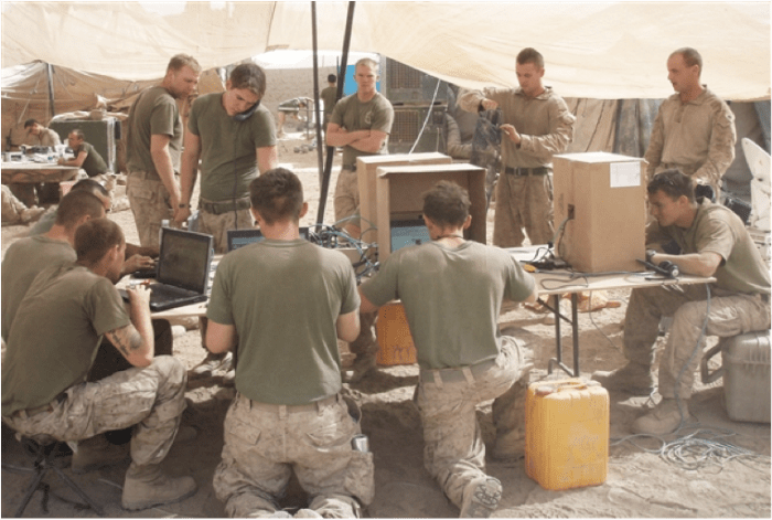 Figure 1 Marines using field internet lounge