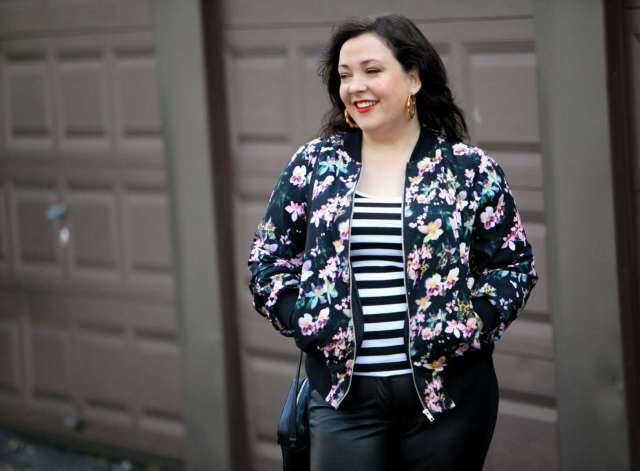 Wardrobe Oxygen, over 40 fashion blogger in floral bomber from Gwynnie Bee and faux leather front ponte pants
