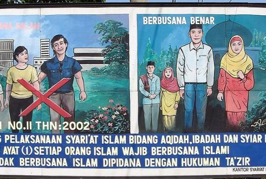 Indonesia, Anti-Western Billboard enforcing Muslim dress, by Nick Treacy (2005, CC3)