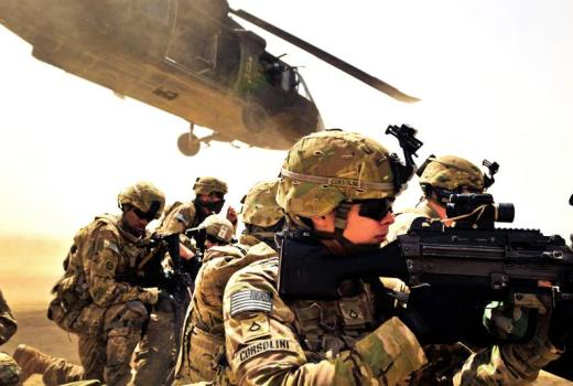 Pfc. Samuel Corsolini, a gunner assigned to F Company, 2nd Battalion, 25th Aviation Regiment, 25th Combat Aviation Brigade, pulls security with other Pathfinders as a UH-60 Black Hawk helicopter takes off after unloading his team and members of 2nd Afghan National Civil Order Patrol Special Weapons And Tactics Team during a vehicle interdiction as part of Operation Pranoo Verbena in order to disrupt Taliban operations in Kandahar province, Afghanistan, March 16.