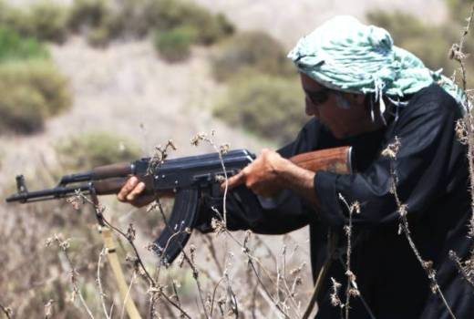 Taliban fighter with AK-47 during US Marine Corps training (USMC, 2011) [880]