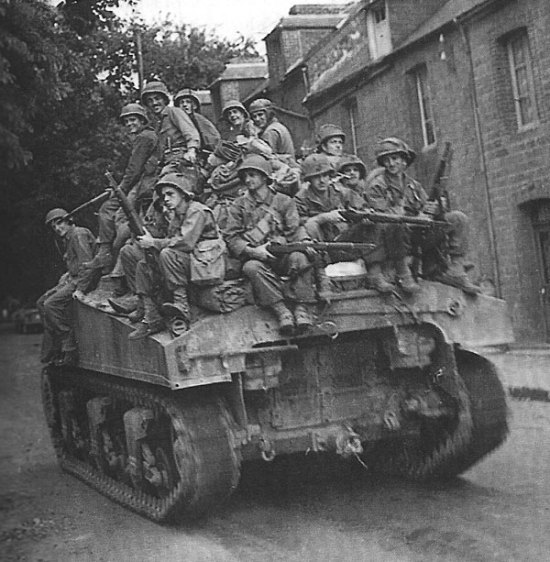 NARA_First-Army-Soldiers-Ride-Sherman-Tank-8-14-1944