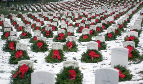 ARLINGTON, Va. (AFPN) -- Christmas wreaths adorn head stones at Arlington National Cemetery. The 14th annual wreath laying event is the result of Worcester Wreath Company's owner Morrill Worcester's, childhood dream of doing something to honor those laid to rest in the national cemetery. More than 5,000 donated wreaths were placed by volunteers this year. (U.S. Air Force photo by Master Sgt. Jim Varhegyi)