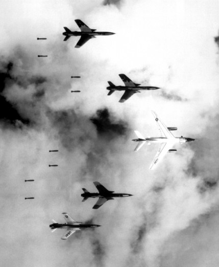 A B-66 Destroyer and F-105 Thunderchiefs release their payload of bombs over North Vietnam as part of Operation Rolling Thunder on 14 June 1966