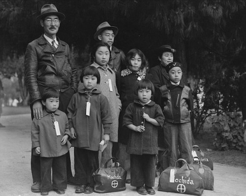 A picture of the Mochida family awaiting relocation, taken on 8 May 1942