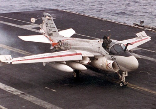 LT Keith Gallagher is seen above the canopy as the A-6 aircraft touches down on the deck of the Lincoln. Note that LT Gallagher's parachute has deployed and is wrapped around the tail of the aircraft. (Navy photo)