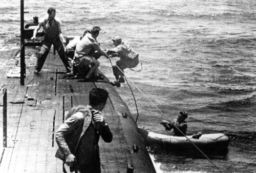 USS Tang rescuing airmen off Truk in May 1944.