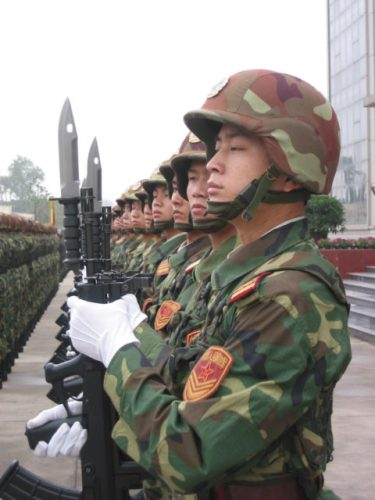 Chinese soldier with QBZ-95 rifle and multi-purpose knife bayonet.