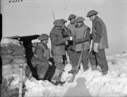 The 2nd Battalion, Royal Norfolk Regiment on February 26, 1940 in France receiving their rum rations before patrol duty Photo Credit