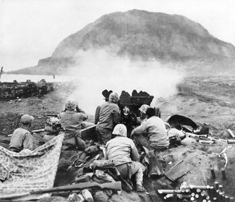 US soldiers pounding Japanese cave positions on Mt. Surabachi on Iwo Jima Photo Credit