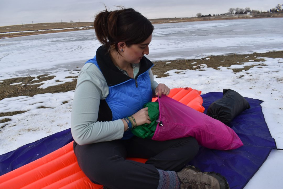 woman with stuff tent sack warmlite