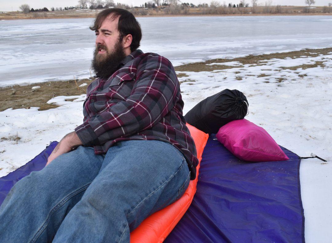 man on air mattress