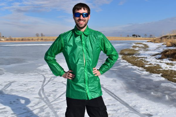 man in green rain jacket