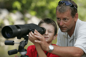 kid with spotting scope