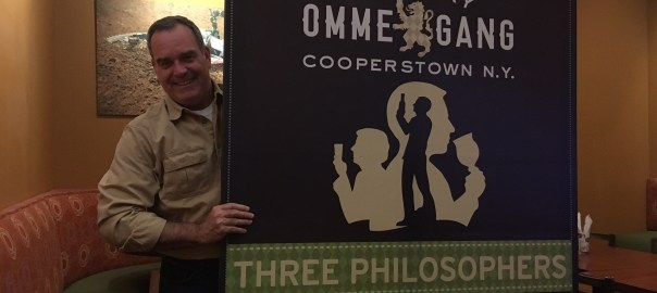Bryan wins raffle, an Ommegang poster