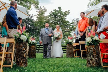 Bride and Father of Bride entrance during outdoor ceremony