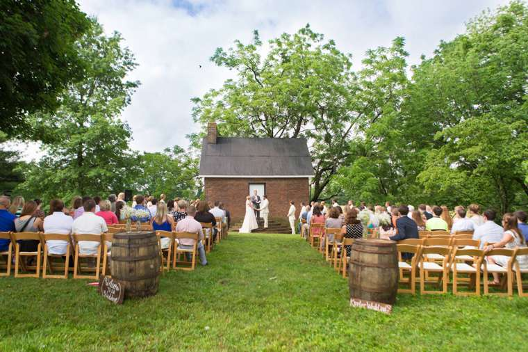 Wedding Ceremony in front of historic Warrenwood Manor cottage