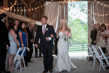 Father walks Bride down the aisle during chic barn wedding