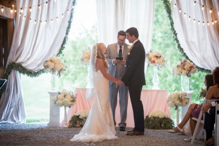 Bride and Groom during their southern glam barn wedding ceremony