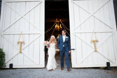 Couple exit their southern glam barn wedding ceremony