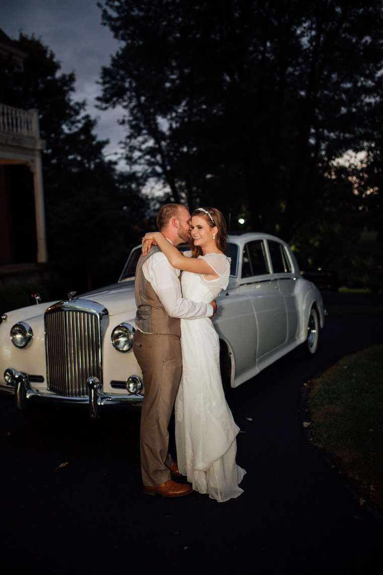 Bride & Groom with their classic Rolls-Royce Get-Away Car