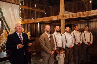 Groom and Groomsmen await the Bride in barn wedding ceremony