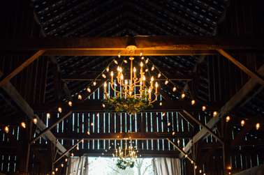 Chandeliers drapped in greenery in the Warrenwood Barn