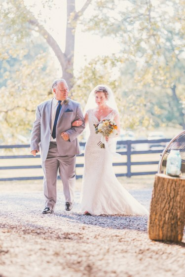 Bride and Father of Bride enter barn