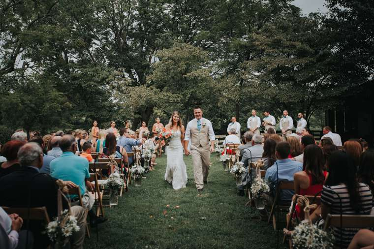 Rustic country outdoor ceremony at Warrenwood Manor, a Kentucky wedding venue.