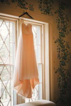 Wedding dress hanging in the Warrenwood Manor bridal suite