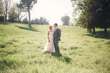Bride & Groom in field at spring farm wedding in Kentucky