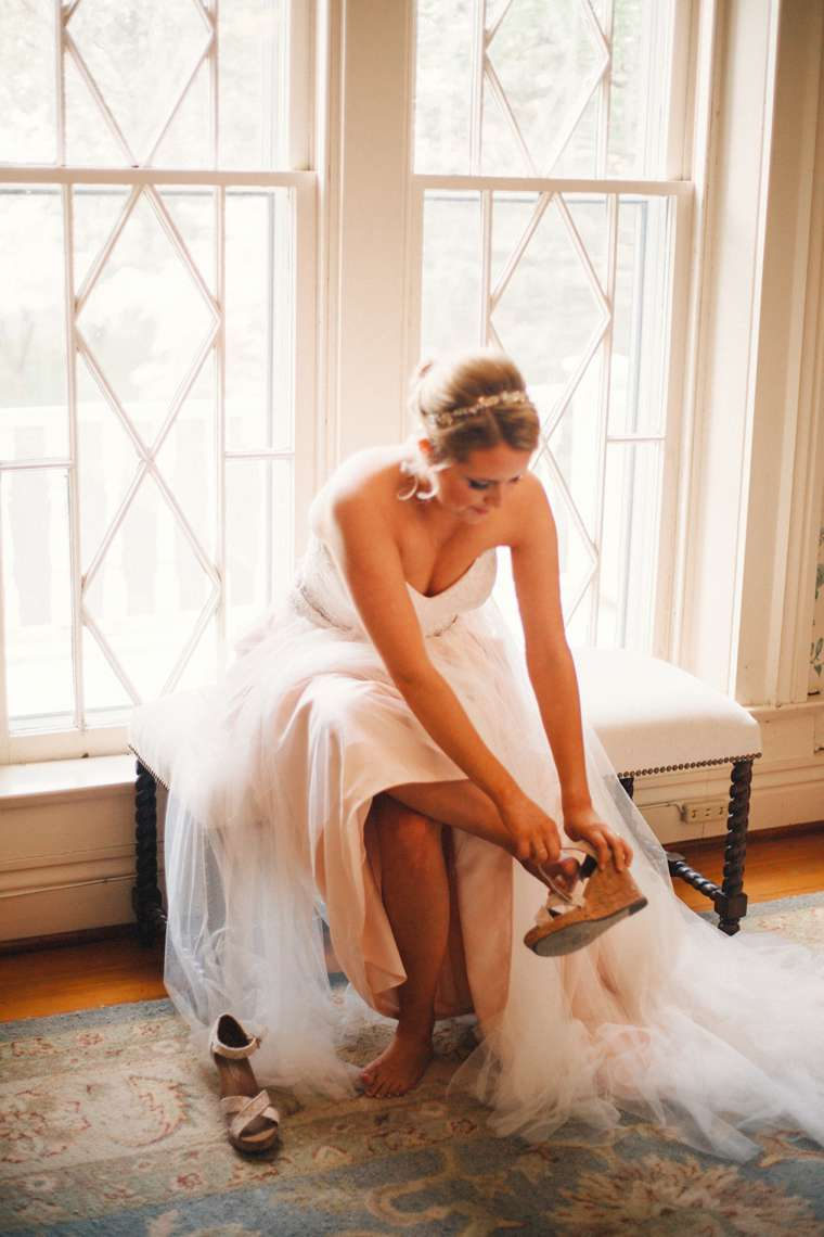 Bride getting ready in the Warrenwood Manor bridal suite