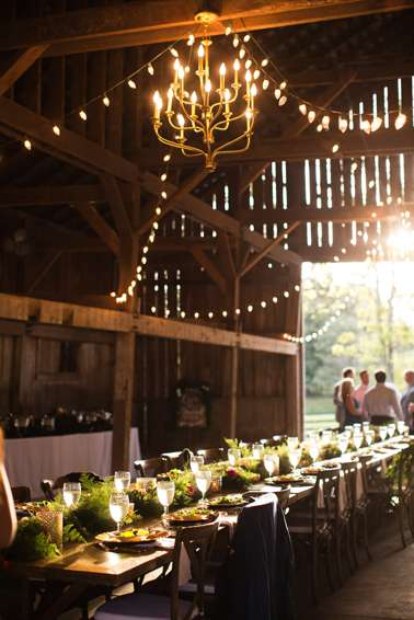 Banquet style reception in barn