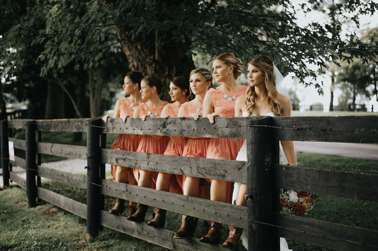 Refined rustic country bridal party in coral dress and boots
