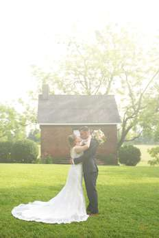 Bride & Groom in front of cottage