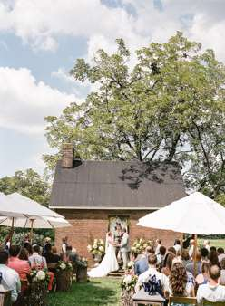 Soft southern glam wedding ceremony outside at Warrenwood