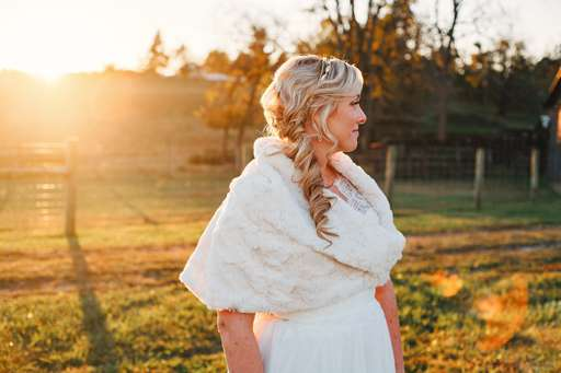 Sunset photo of bride with fur shaw