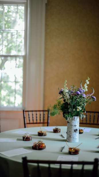 Rustic wildflower centerpiece on sage linen. Grant Aumiller Photography