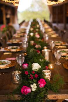 Greenery garland with pink blooms and gold accents down banquet table. Doug Smith Designs & Events. Honey Heart Photography.