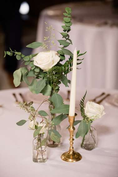 Simple centerpiece with bud vases and candlesticks. Leah Berry Photography.