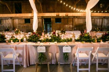 Greenery garland on blush linen with gold accents at head table. Hilly Photography. Jeanie Gorrell Floral Design.