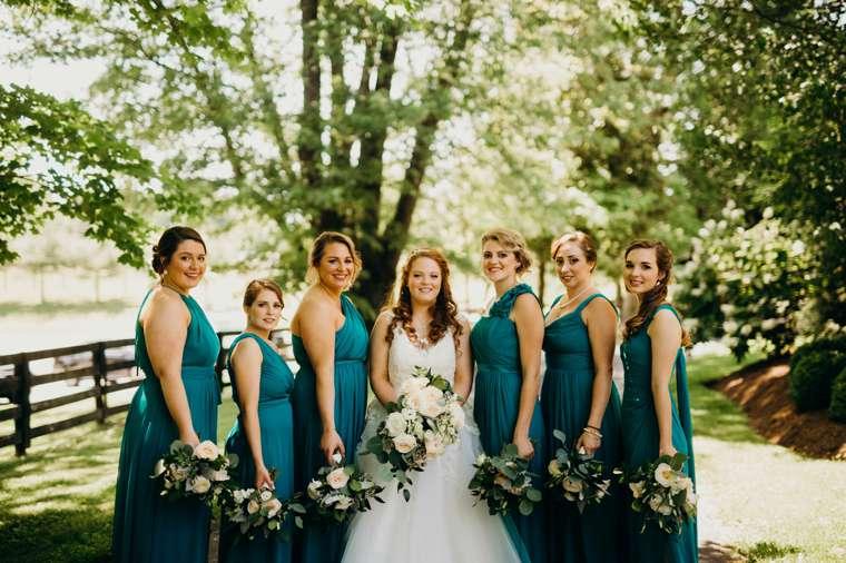 Bridesmaids dressed in teal at Kentucky summer farm wedding