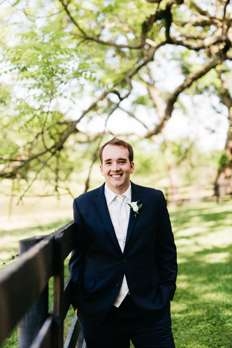 Groom dressed in navy blue and ivory at Kentucky estate wedding