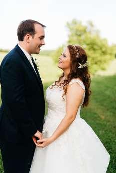 Bride & Groom against rural Kentucky landscape at top rated wedding venue
